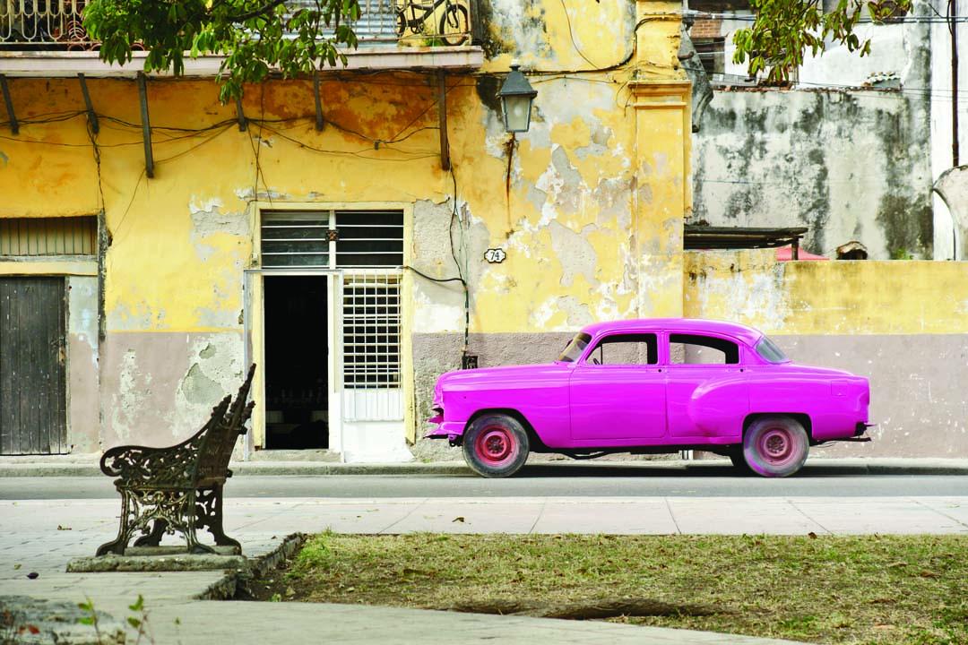 a bright purple car from cuba in havana