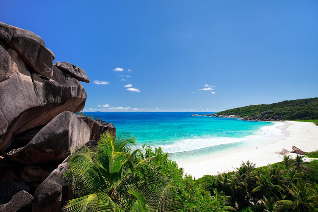 White sandy beach and turquoise clear waters of Grand Anse on La Digue island