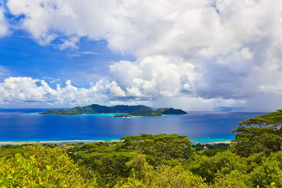 Praslin Island from a distance showing beaches and lush greenery
