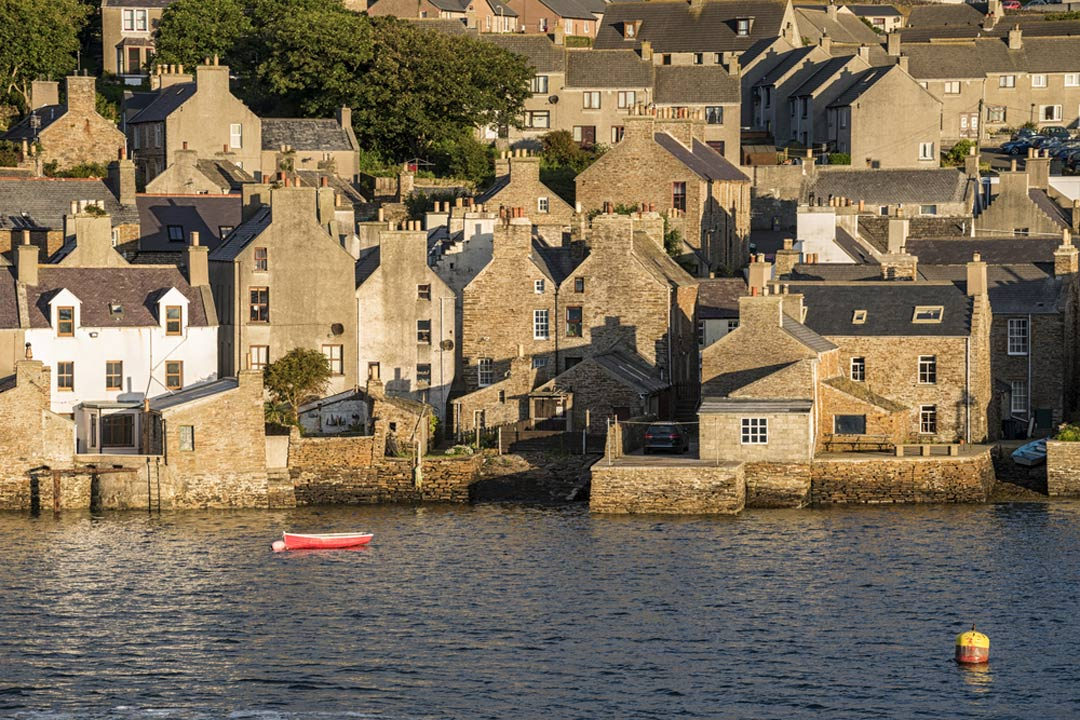 Stone cottages lining the Orkney coast in Stromness