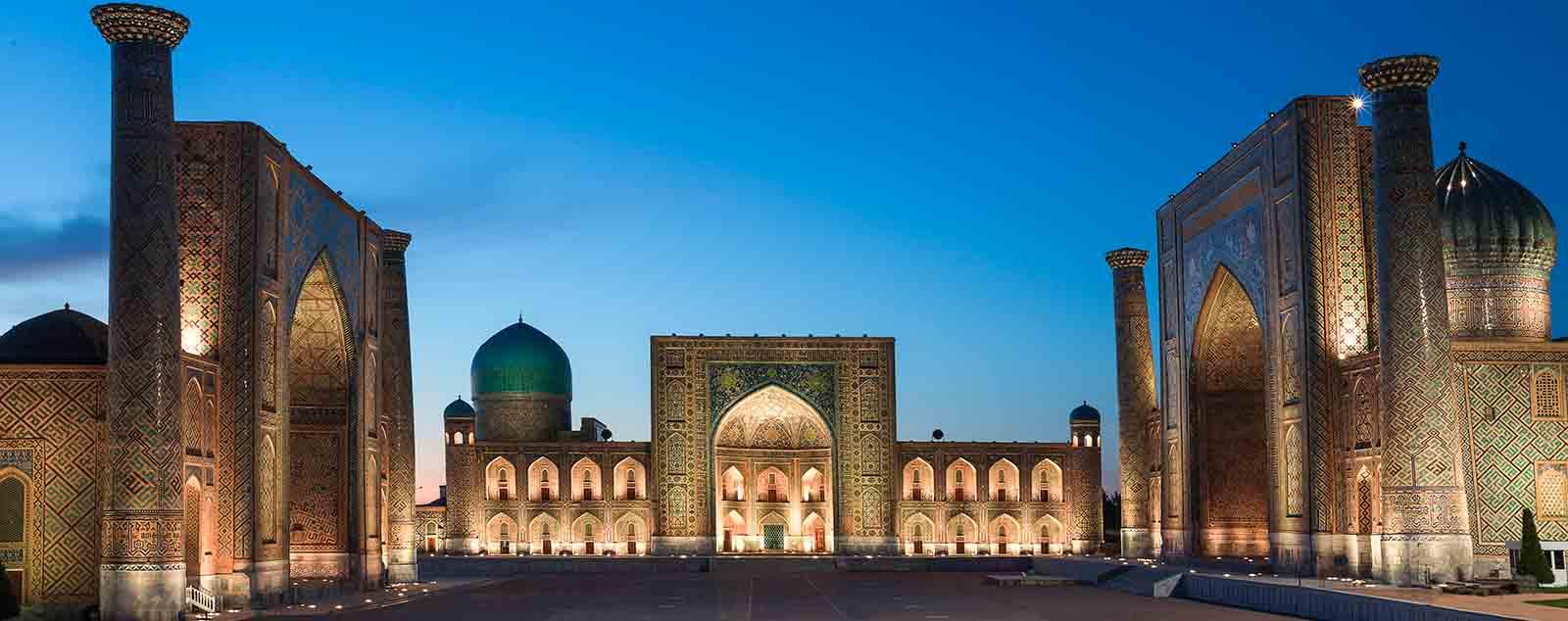 The three huge madrasahs of Registan Square illuminated at night