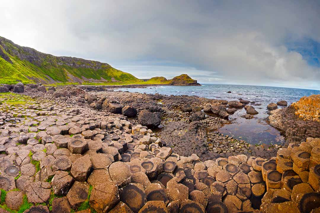 The iconic columns of the Giants Causeway next to the sea
