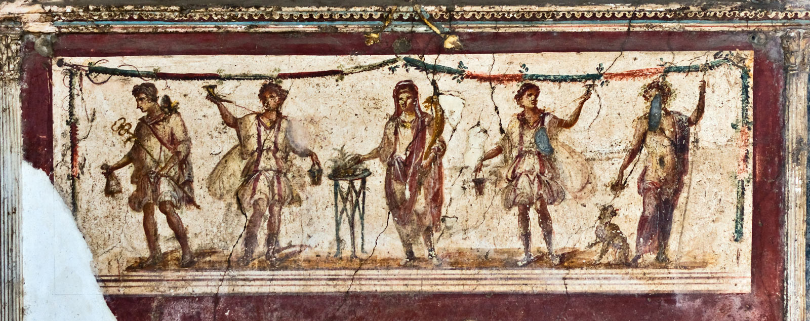 An old mural of several traditionally dressed Roman figures