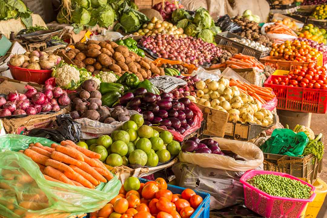 Colorful fruits and vegetables colorfully arranged at a local fruit and vegetable market in Nairobi
