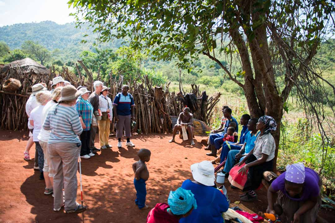 A Traveleyes groups meeting with a local family at a homestead
