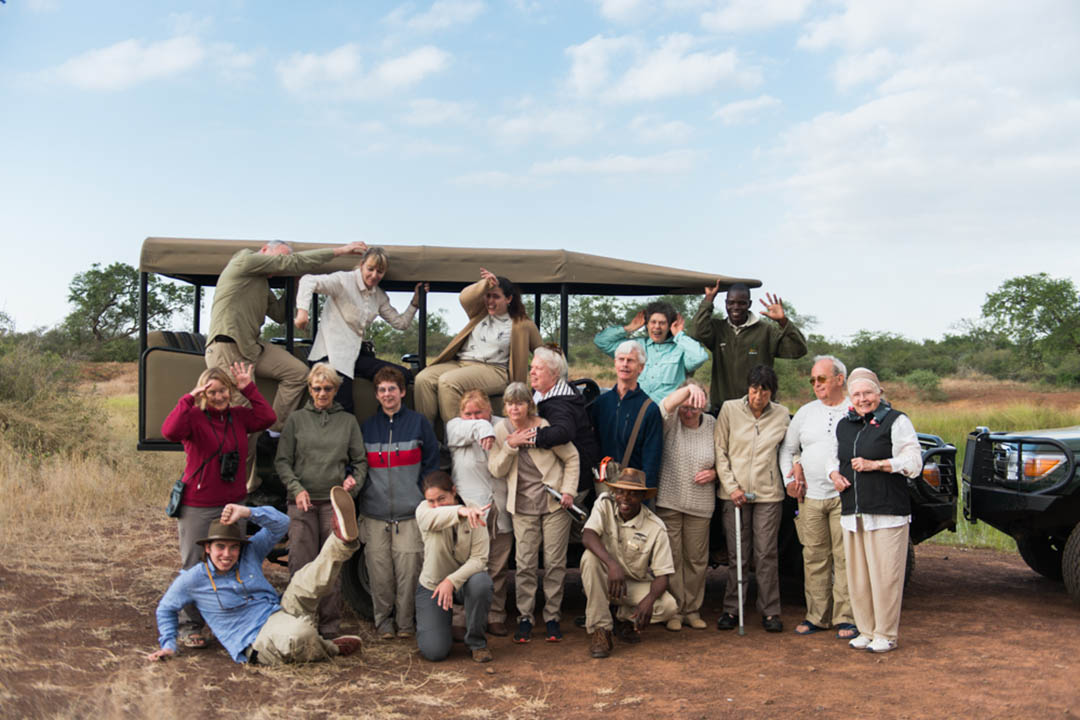 group shot of Traveleyes around a landrover at Hlane