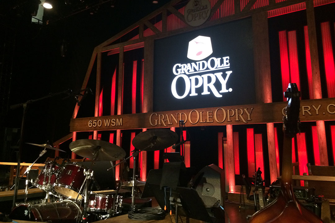 A drum kit on stage at the Grand Ole Opry theatre