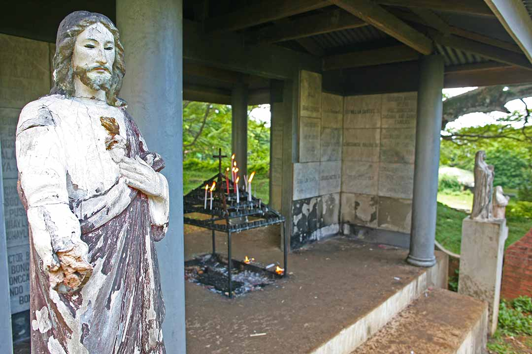 A crumbling statue of Jesus Christ welcomes worshippers to an active Catholic shrine on the island of Siquijor