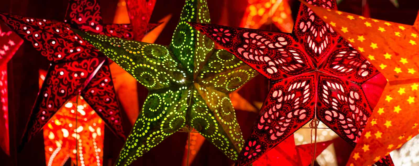 Green and red illuminated Christmas star decorations