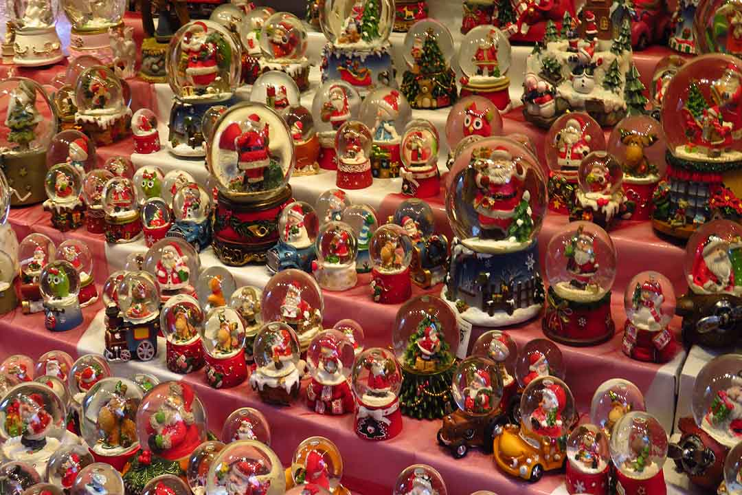 A collection of Christmas snowglobes at a Christmas market.