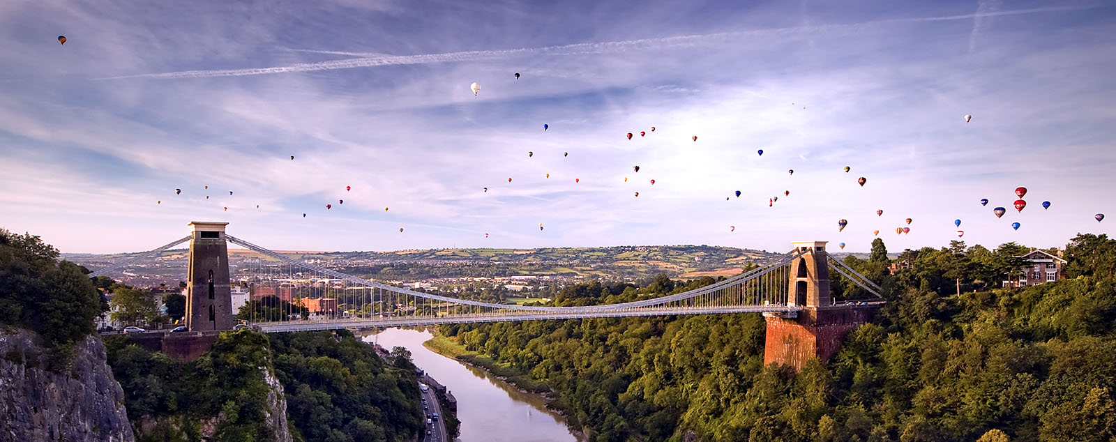 Bristol bridge against the sky filled with hot air balloons