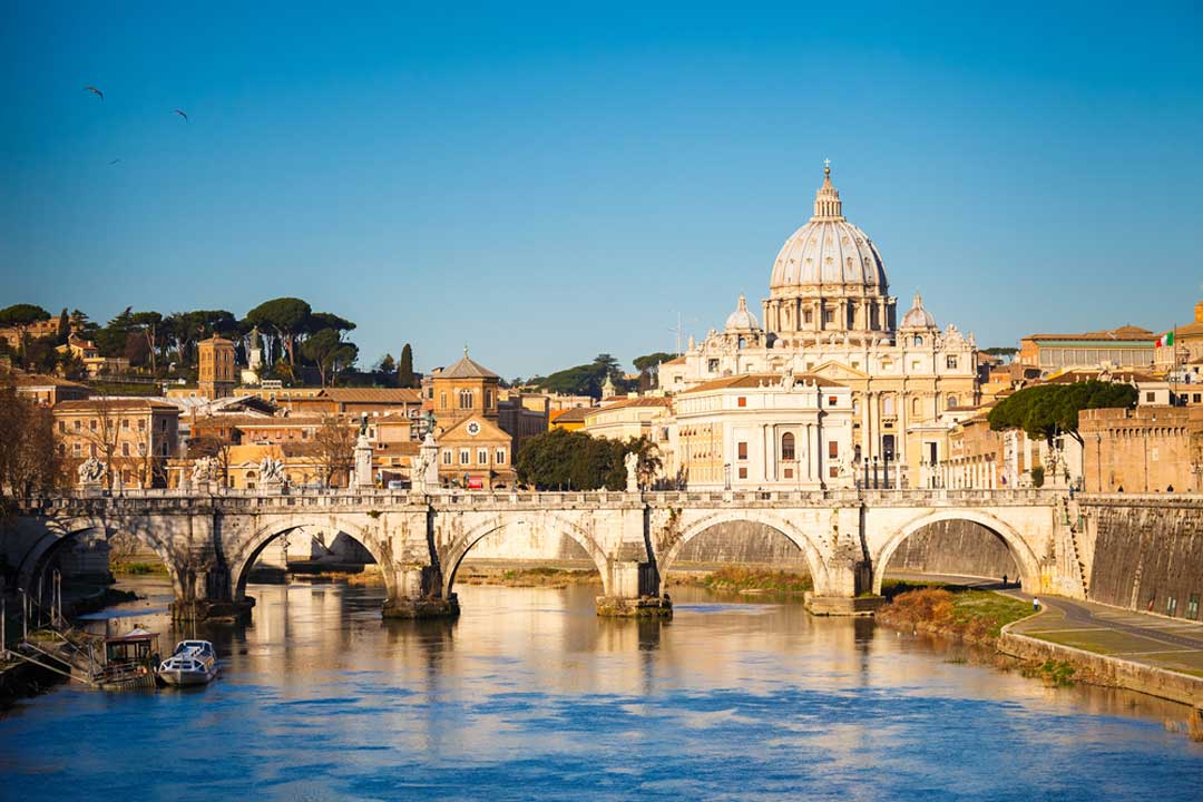 A view up the River Tiber with St Peter's Basilica in the background