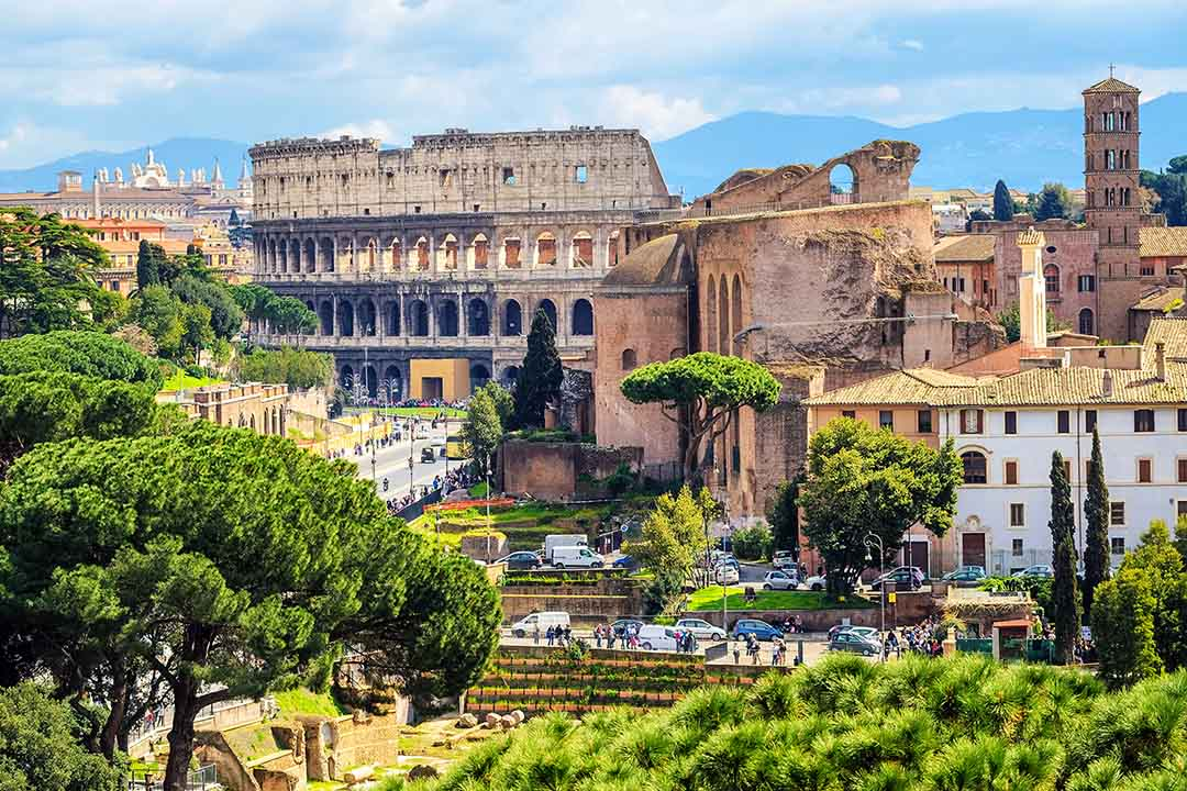 Ruins of antique roman Forum Romanum and Colosseum in the Old Town of Rome, Italy