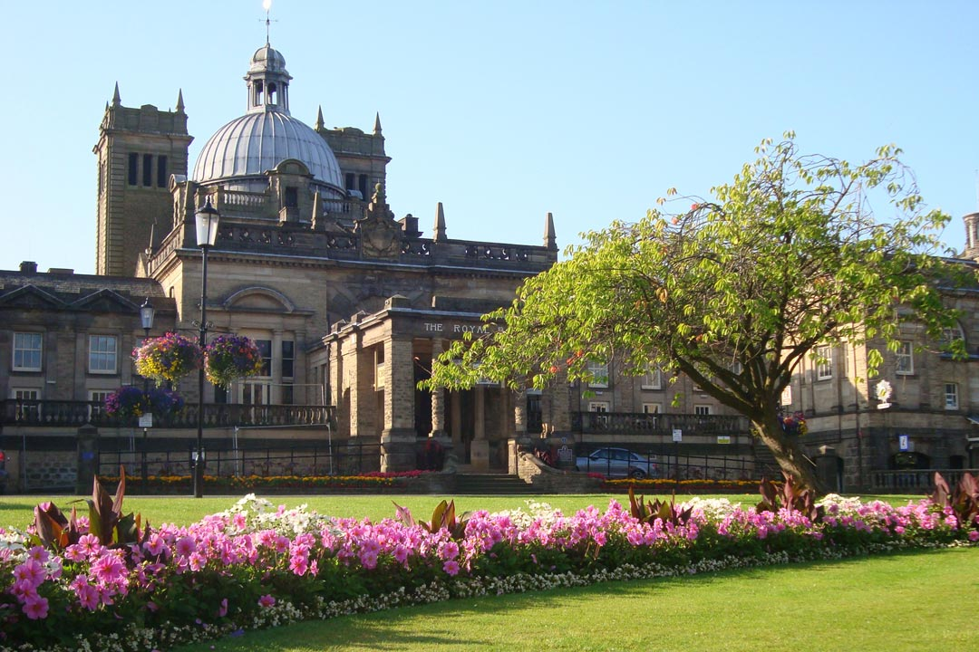 The exterior of the Royal Baths surrounded by wild flowers