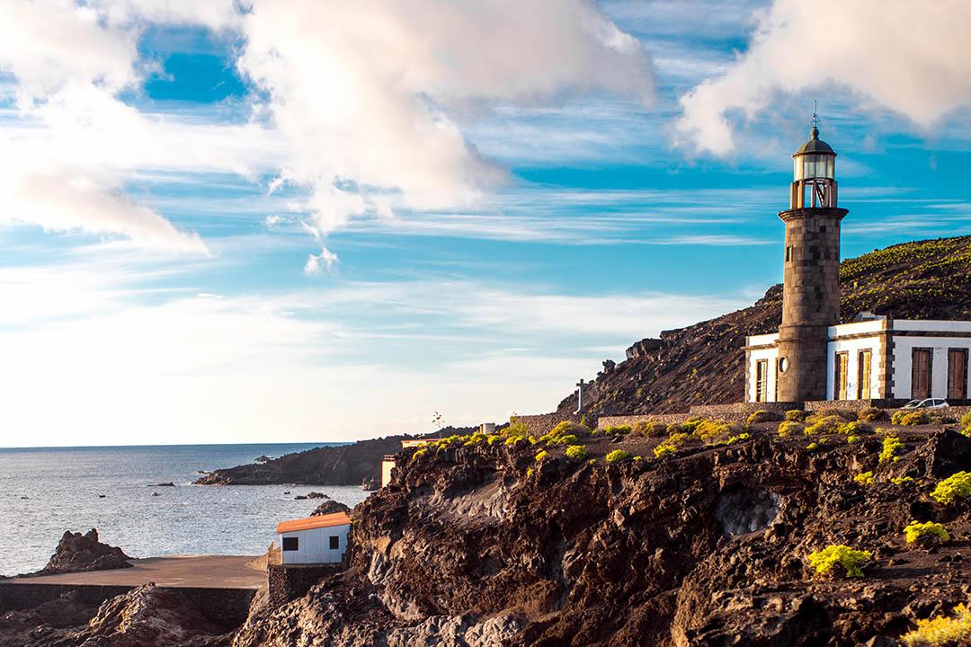 Lighthouse overlooking rocky cliffs