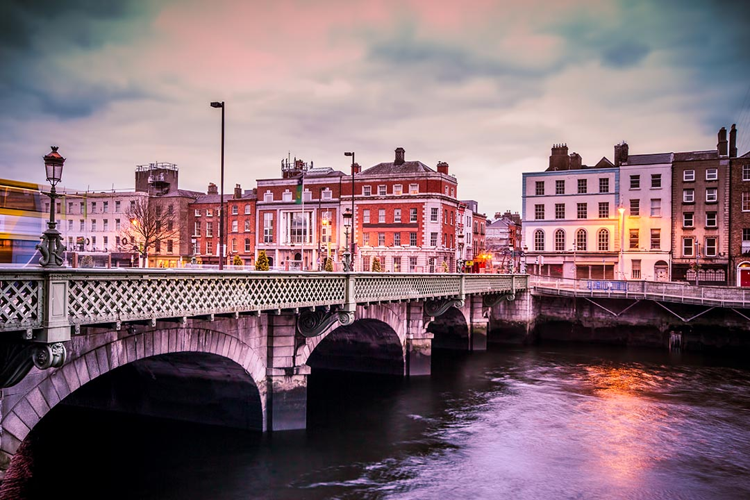Historic Grattan Bridge over the River Liffey in Dublin Ireland at sunset