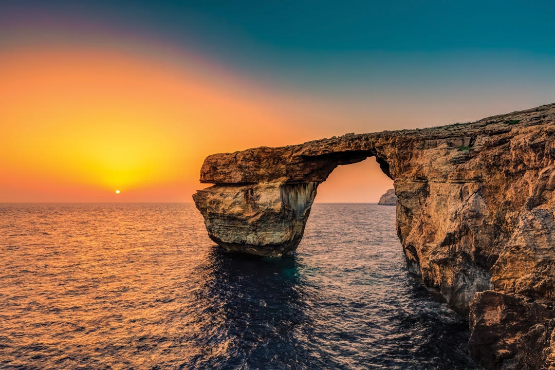 The famed Azure window before it crumbled into the ocean