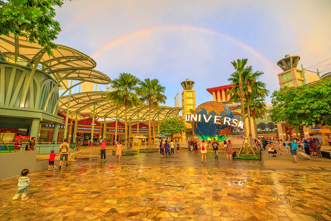 Universal studios beneath a dazzling rainbow