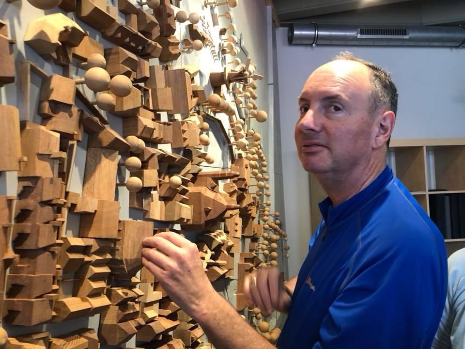 image of Steve feeling the 3D model of the town