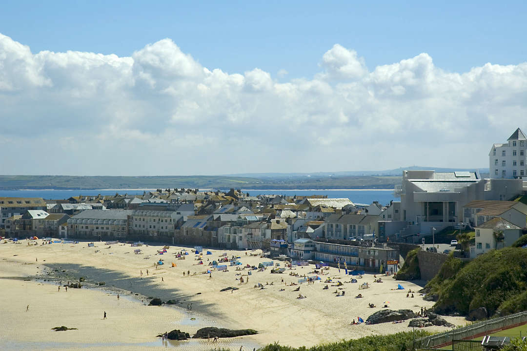 An above view of Porthmear Beach in St Ives with Tate St Ives on the right hand side