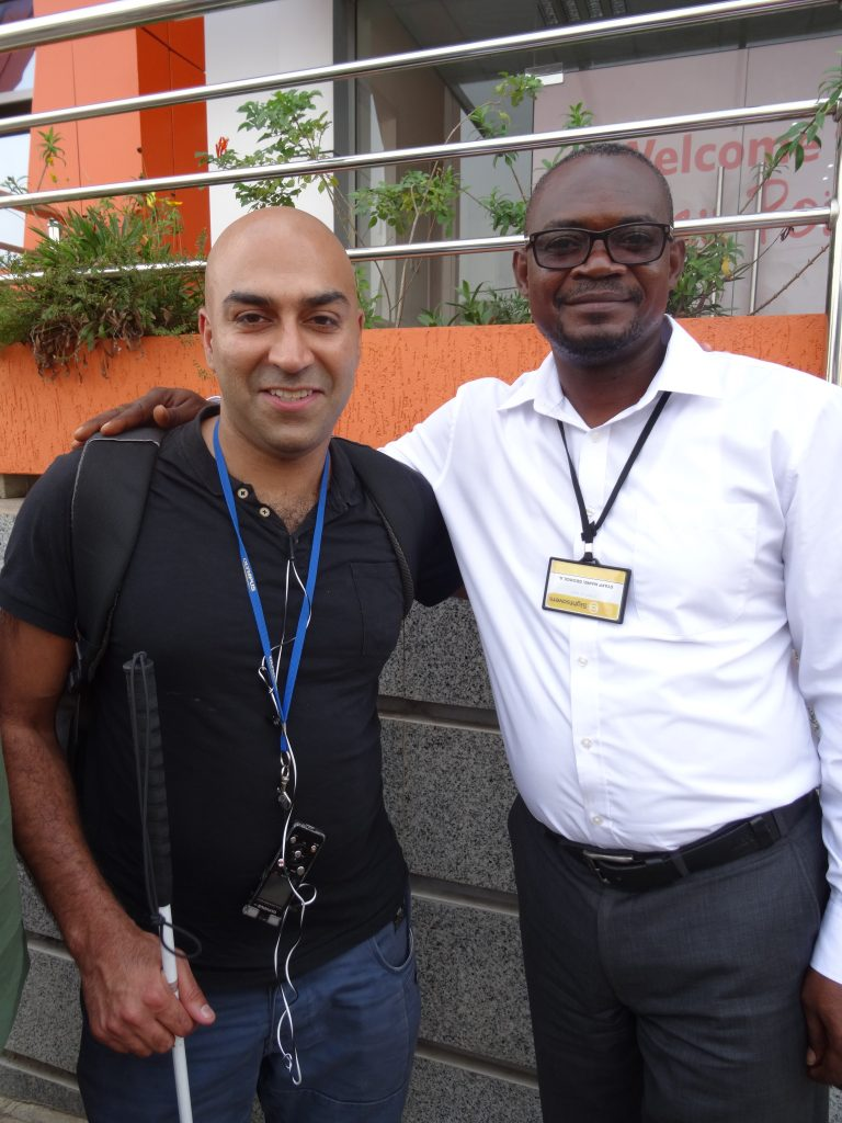 Image of Traveleyes founder Amar Latif with one the Sightsaver representatives in Ghana