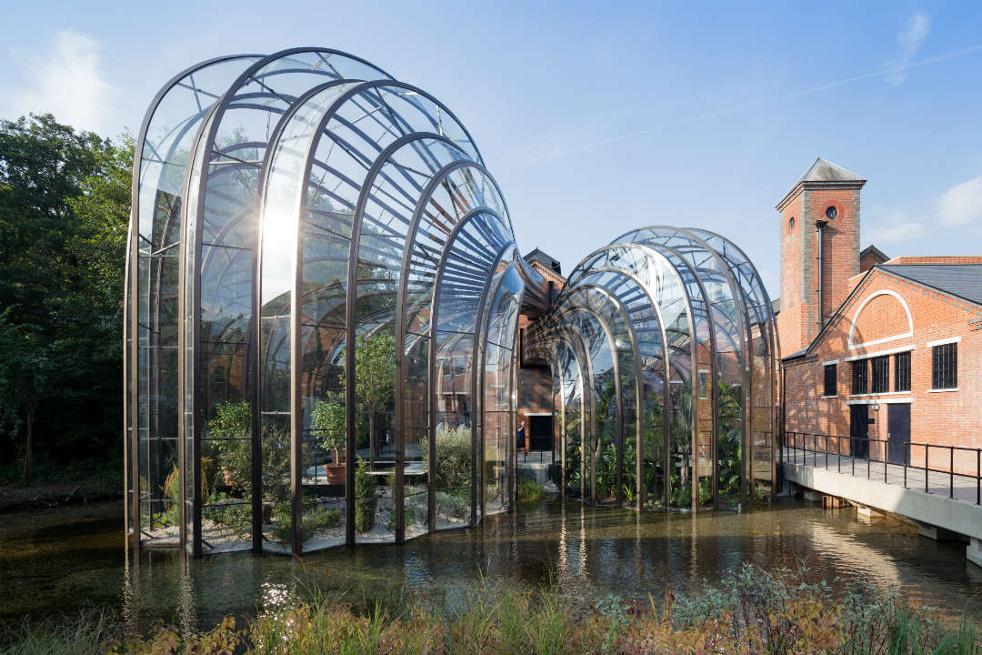 A wide picture of the glass greenhouses at Bombay Sapphire Distillery