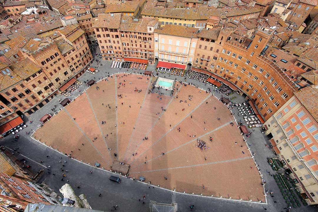 Aerial view of the Piazza del Campo, Siena, Tuscany, Italy as seen through a wide angle lens from the Torre del Mangia.