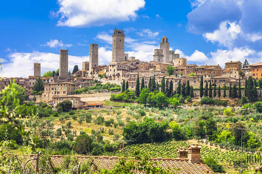 The townhouses and medieval towers of San Gimignano surrounded by greenery