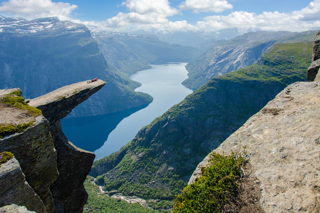 Trolltunga - a shelf of rock sticking out over a Norwegian Fjord