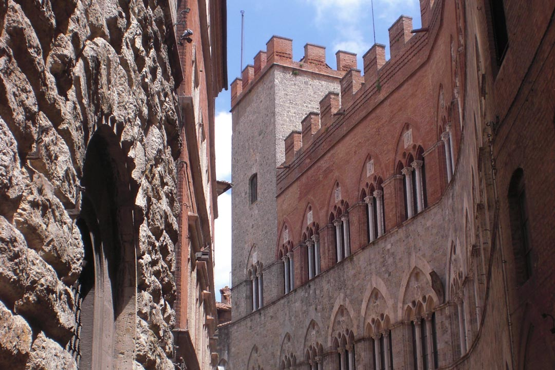 A traditional gothic Italian street in Siena
