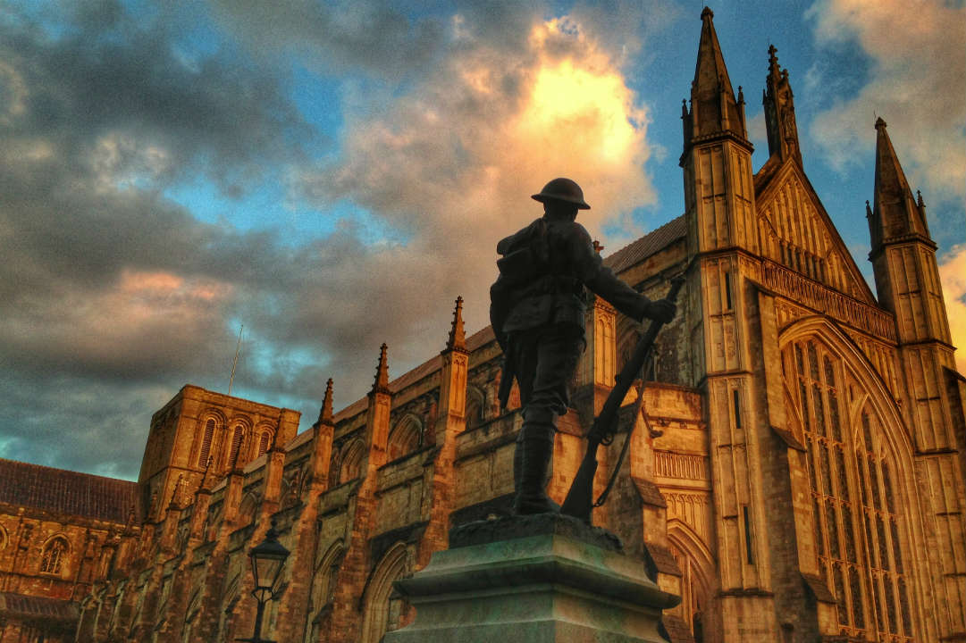 Statue outside Winchester Cathedral at sunset