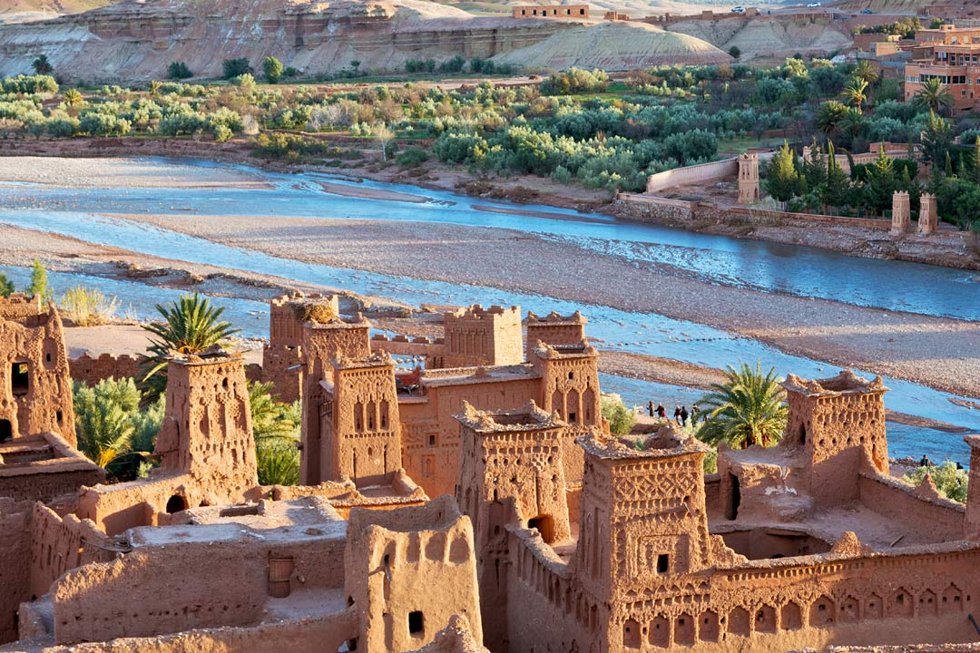Old Moroccan fortifications line a river bank