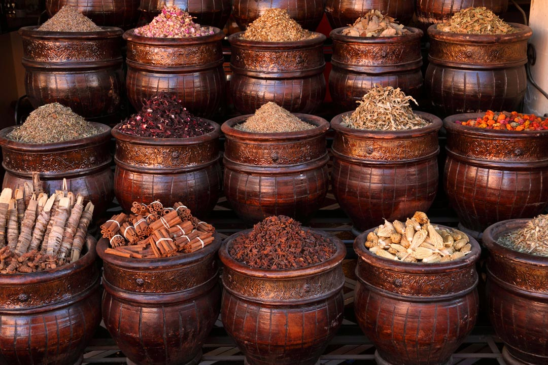 Decorated wooden baskets filled with various spices and herbs ready to be samples and purchased