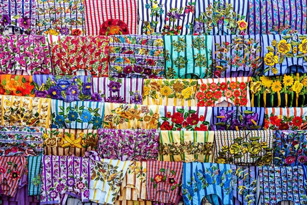 Brightly coloured woven clothes, representative of the vibrancy of Guatemala.