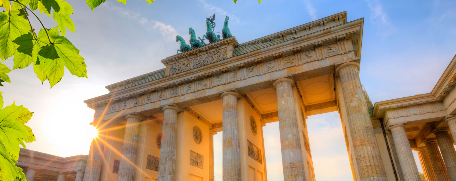 The Brandenburg Gate with sun shining behind