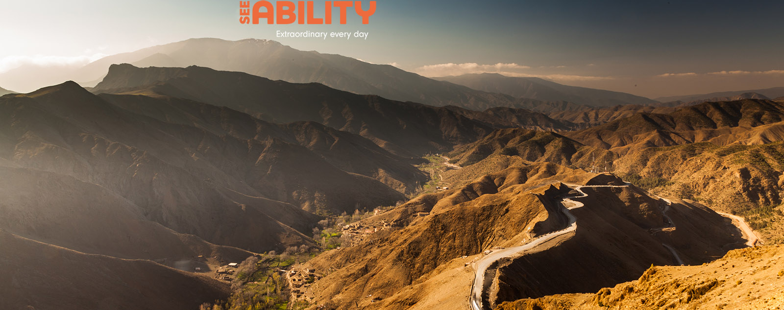 Panoramic view of the Atlas Mountains with mule paths and green valleys below