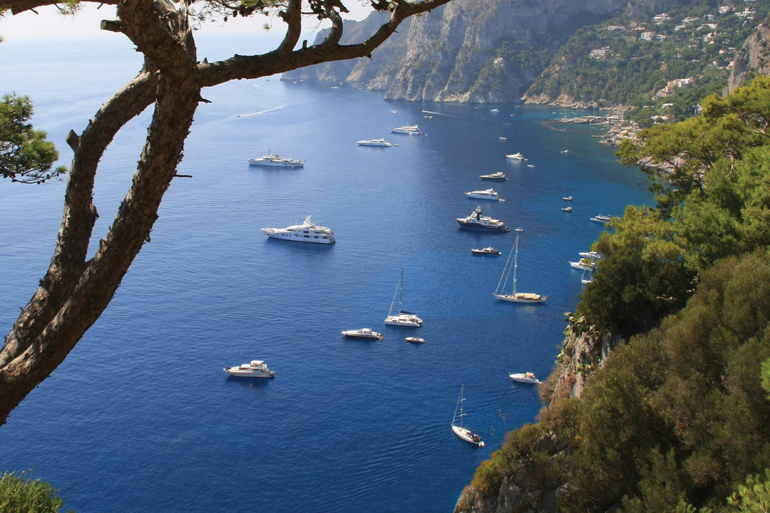 A birds eye view of boats in the water near Sorrento