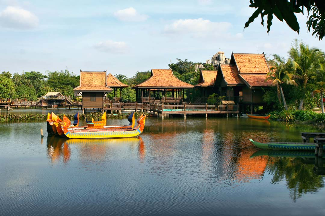 A boat travels towards traditional floating villages