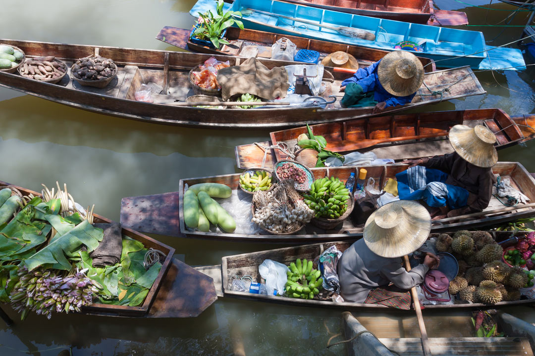 Birds eye view of boats selling fruit and veg at a floating market