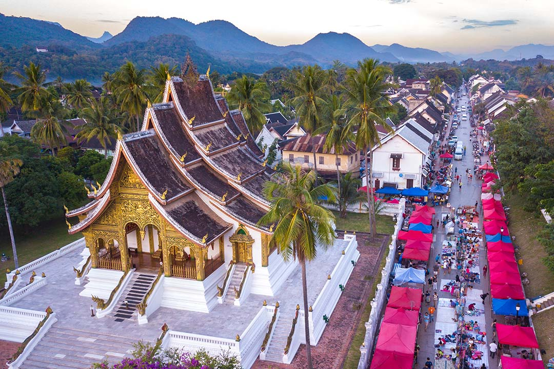 A sky view of the main street of Luang Prabang, with the cities temple and the night market next to it