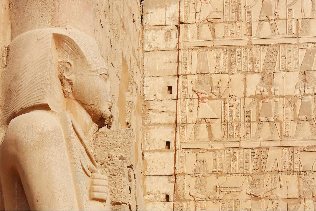 A carved pharaoh against the ancient walls