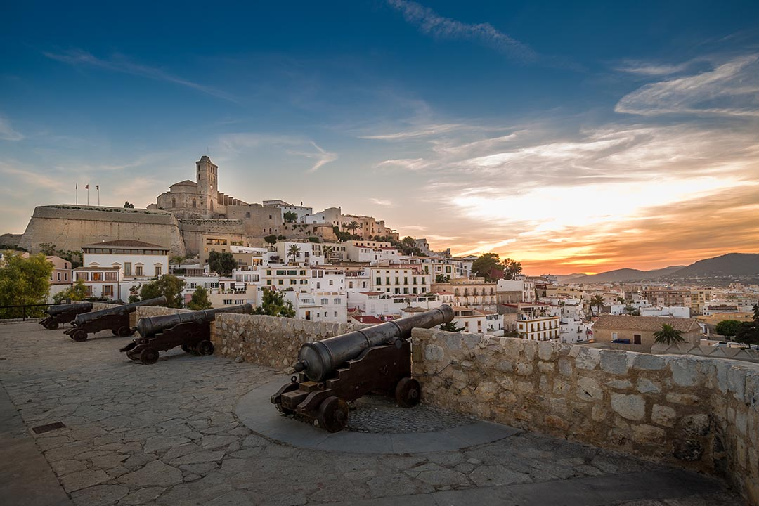 Ibiza fortress and cannon square at sunset. Eivissa island, Spain