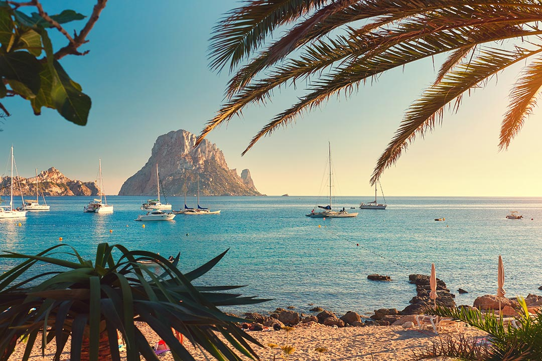 Cala d'Hort beach. Cala d'Hort in summer is extremely popular, beach have a fantastic view of the mysterious island of Es Vedra. Ibiza Island, Balearic Islands. Spain