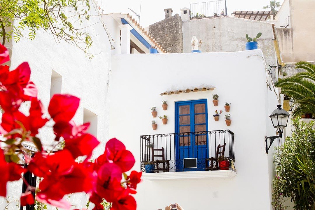 Ibiza white island architecture corner bougainvilleas flowers Balearic Spain