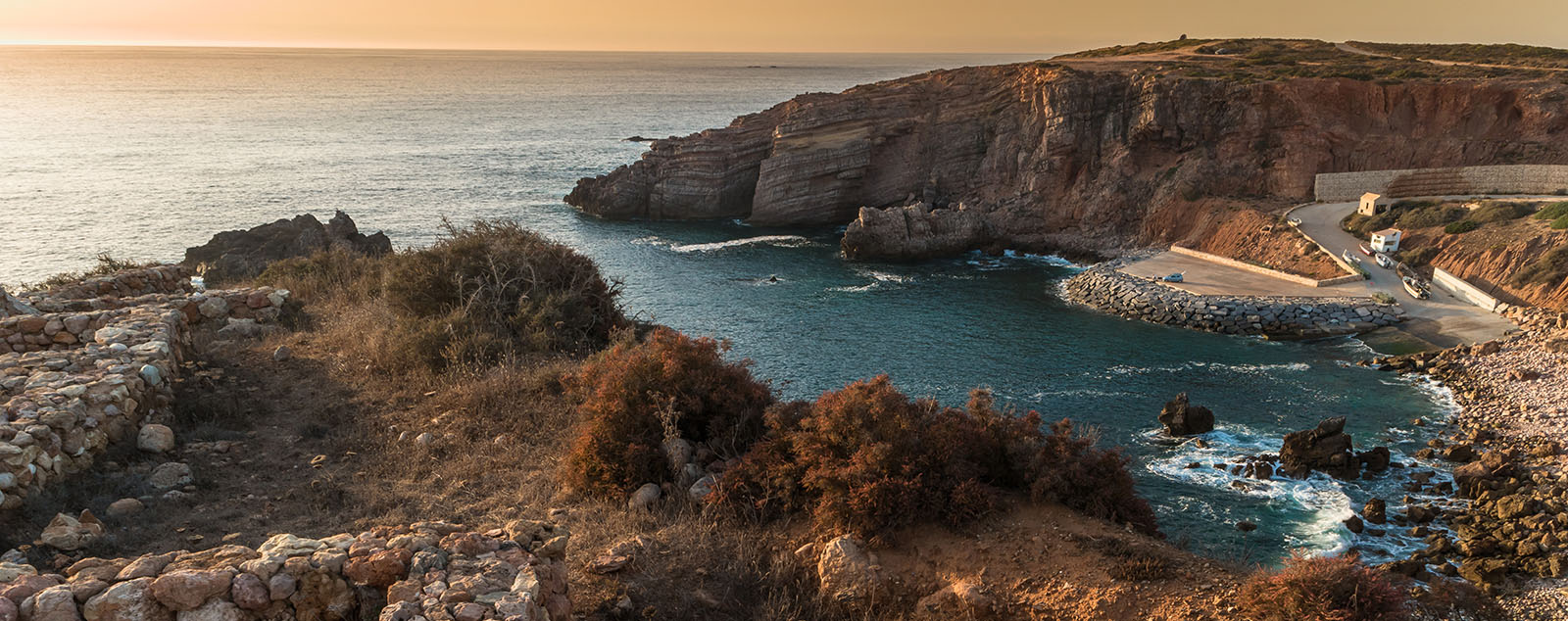 Sunset on Fishermen Settlement in Ponta do Castelo by Carrapateira at Aljezur - Portugal. Summer Atlantic rocky coast view (Costa Vicentina Algarve).