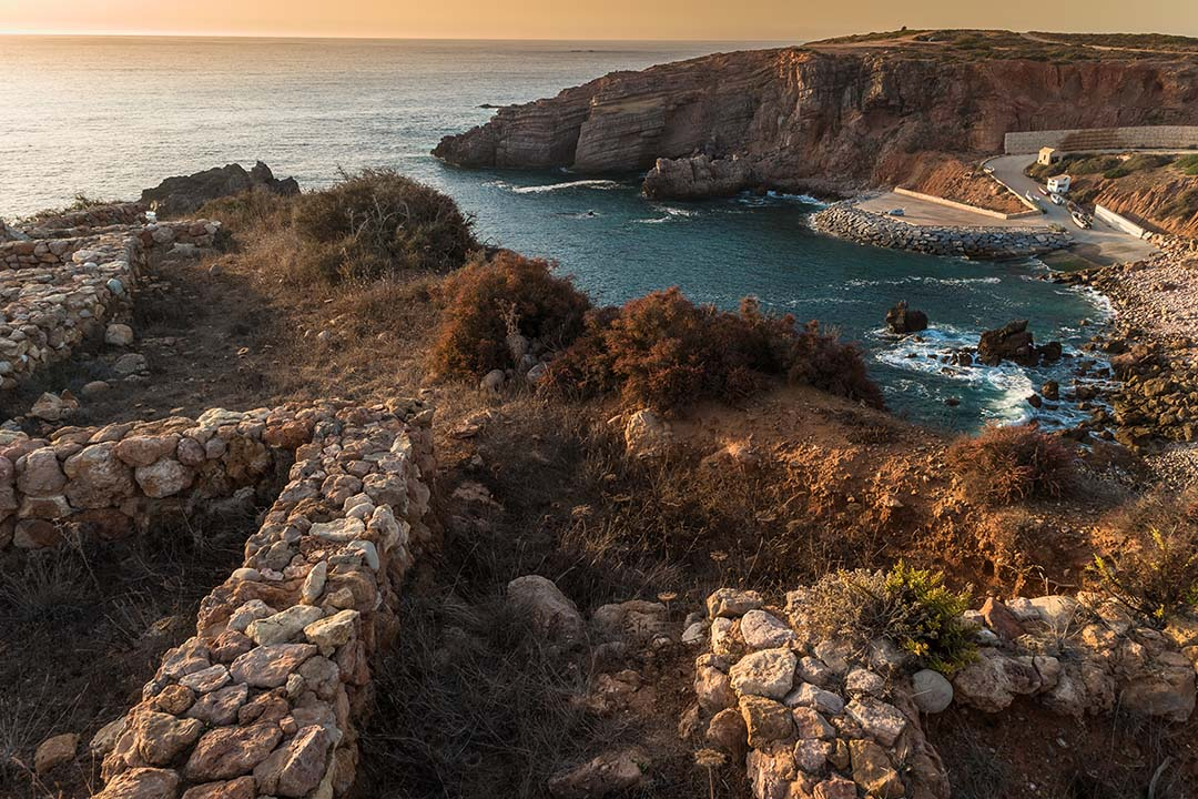 Sunset on Fishermen Settlement in Ponta do Castelo by Carrapateira at Aljezur - Portugal. Summer Atlantic rocky coast view (Costa Vicentina Algarve).