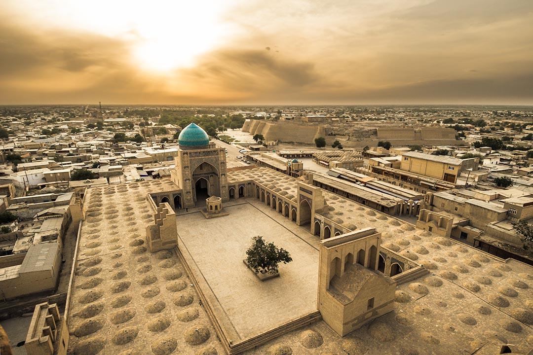 Panorama of Bukhara, Uzbekistan with sunsetting over horizon