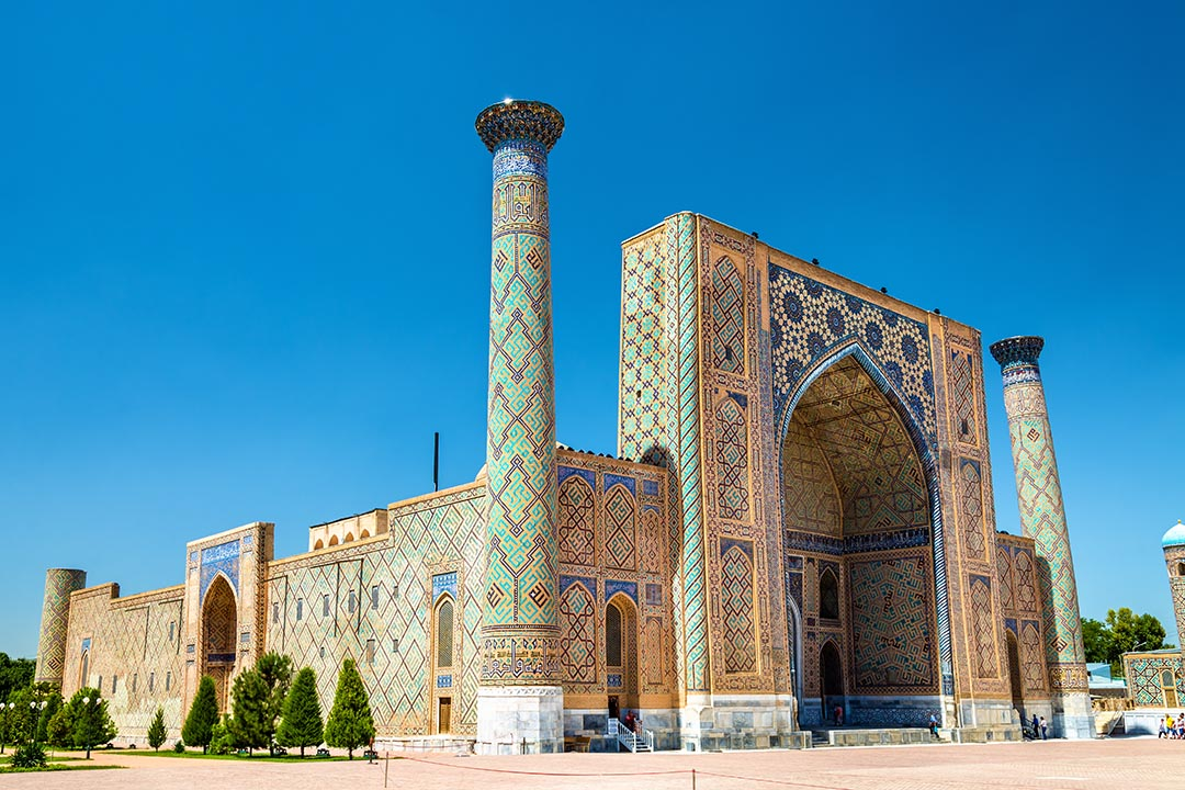 Ulugh Beg Madrasah on Registan square in Samarkand with blue and green mosaic tile detail