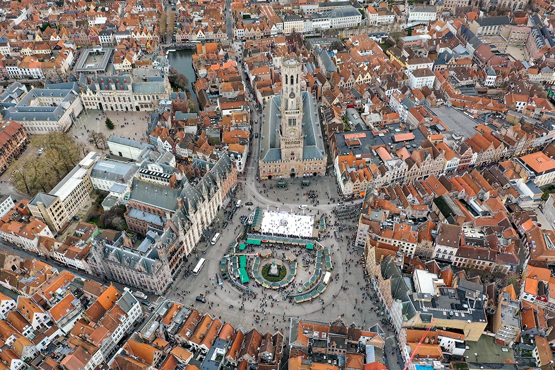 Bruges Aerial City View feat. Belfry of Bruges medieval bell tower historical landmark and iconic famous Market Square Europe tourist attraction in Belgium