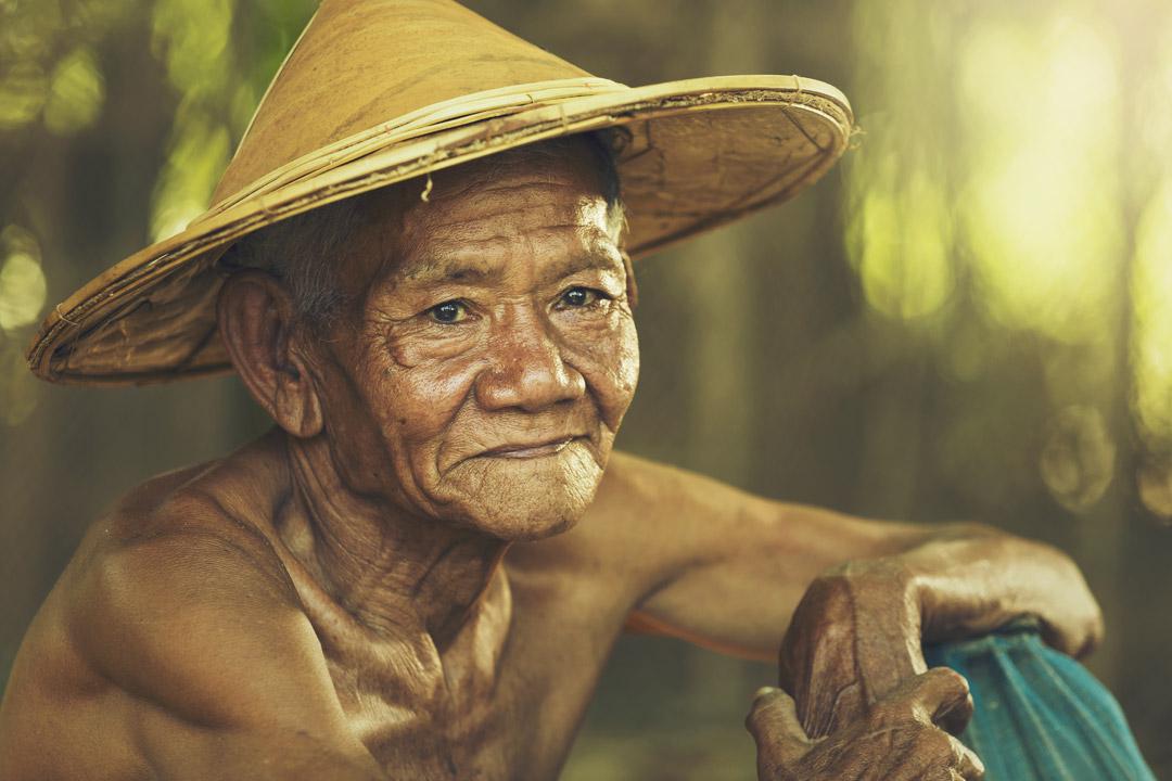 old Burmese man sat down